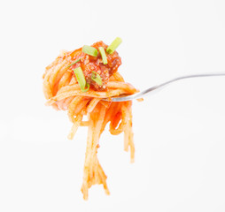 Spaghetti bolognese being eaten with a fork