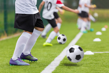 Football soccer training for youth teams. Young footballers kicking soccer balls