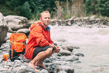 Tourist refresh on the mountain river bank