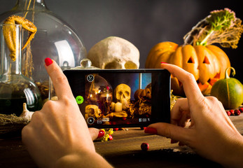 Witches table. Halloween or esoteric concept. Photographed on a smartphone. On a black background.