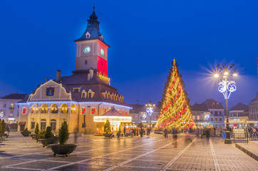 Decorated Christmas tree and lights in the main square of Brasov, beautiful medieval town of Transylvania, Romania