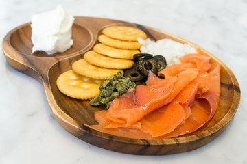 Salmon cream cheese with biscuit caper and black olive
