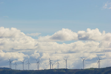 Wind turbines generating electricity on the top of the mountain, wide shot