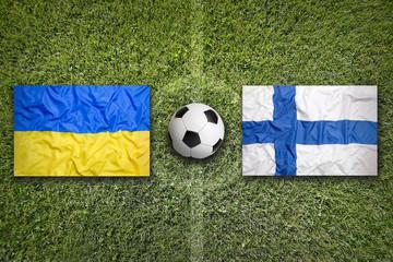 Ukraine vs. Finland flags on soccer field