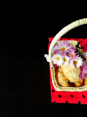 A basket with croissants and flowers prepared for picnic