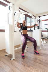 Healthy Young Woman Exercise Chest On Machine
