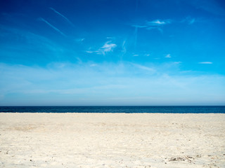 View of the beach, sea and sky on a sunny day.