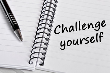 The words Challenge yourself on notebook