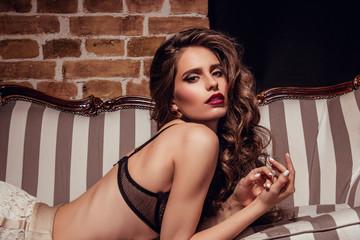 Beautiful sexy woman posing on chair
