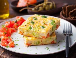 Omelet with smoked salmon and broccoli on a plate