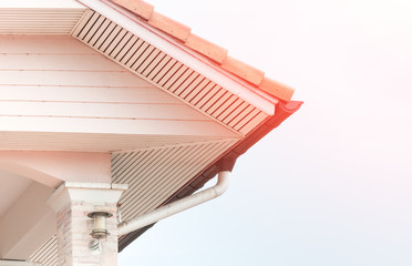 Weathered roof with rain gutter of roof top of house