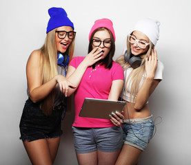 hipster girls friends  with digital tablet