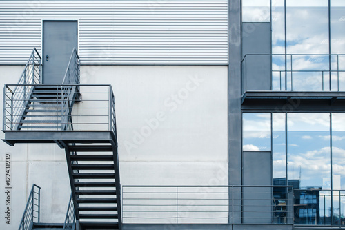 Fire Escape Staircase In A Modern Office Building / Business Building With  Metal Emergency Staircase