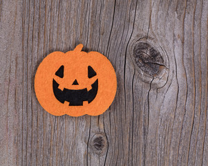 Bright scary pumpkin decoration on rustic wooden boards