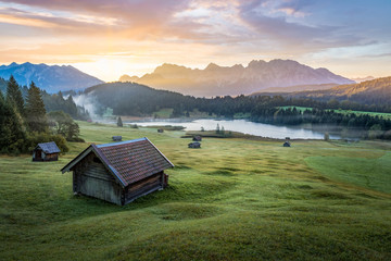 View over Geroldsee with wooden hut and Karwendel mountains at early morning, Bavaria, Germany Wall mural