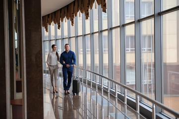 Couple at airport waiting aircraft