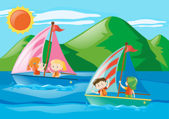 Children sailing boats in the sea