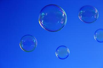 Soap bubbles against blue sky.
