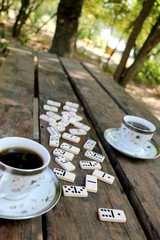 On the table are filled with two cups of coffee scattered bones