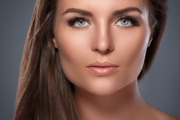 Beautiful  and young woman with a artificial eyelashes