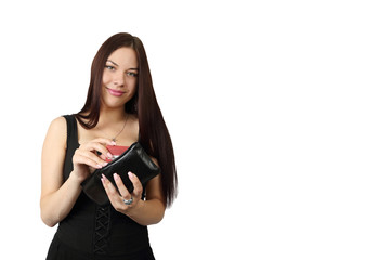 Young pretty long haired brunette woman in black dress takes credit card from purse isolated on white background with copy space for text or advertising