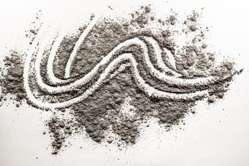 Wave shape illustration drawing made in pile of sand, dust