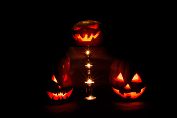 halloween three pumpkins, one on the altar and two as servants a