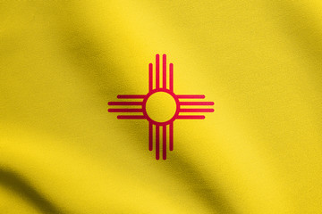 Flag of New Mexico waving with fabric texture