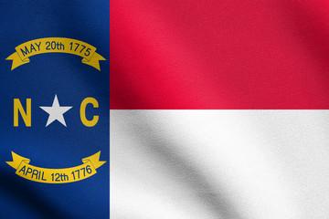 Flag of North Carolina waving with fabric texture