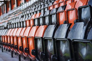 Foto op Plexiglas Stadion Rows of black and red plastic stadium seats, depth of field conc
