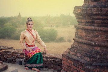 Beautiful girl in Myanmar traditional costume, identity culture