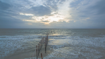 aerial photography the old broken pier made by wood  in the  Andaman sea locate on Phang Nga province Thailand