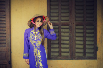 Portrait Asian girls with Ao-Dai Vietnam dress, Ao dai is famous