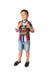 Cute Arabic looking little boy in short jeans stays with vintage camera - full height portrait isolated on white background