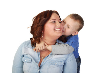 Plump woman and little boy - Happy childhood - Son kisses mother isolated on white background