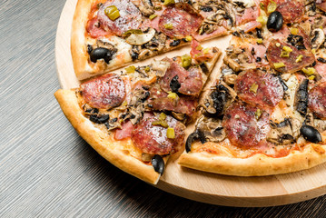 pizza on the wood background
