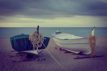 Fishing boats on the beach with vintage effect