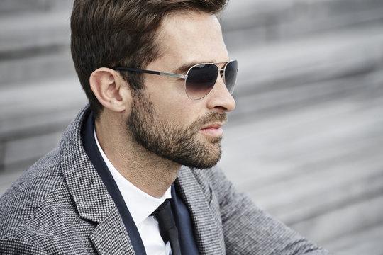 Businessman in sunglasses, profile