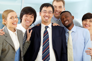 Group of happy business people looking at camera