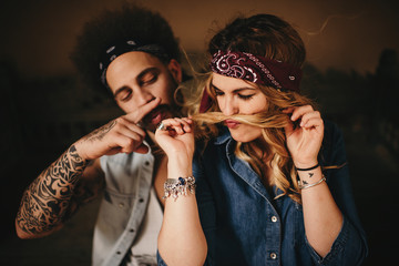 Couple making moustache with hair and finger