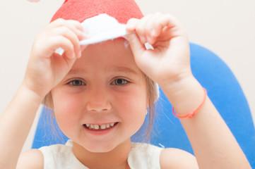 girl in the santa claus hat