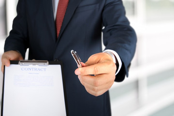 Business man is offering to sign  a contract, business contract