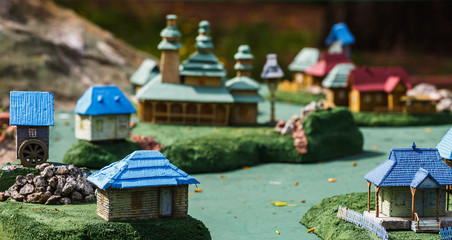 Ukrainian village with houses and a church in miniature