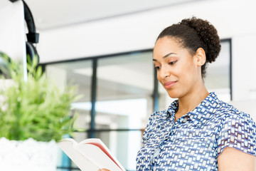 Portrait of smiling afro-american office worker sitting in offfice