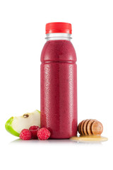 Red smoothie in plastic bottle