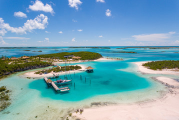 Aerial view of exotic island with authentic buildings and pier for yachts
