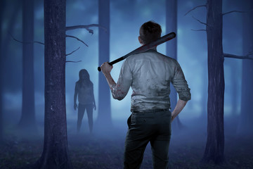 The man in a bloody shirt holding a bloody stick want to hit the lady zombie