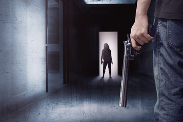Zombie in a dark alley meet a man with a gun