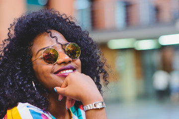 Cheerful afro-american woman in stylish sunglasses