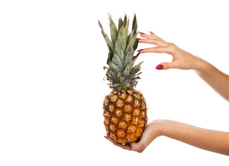 A girl holding a pineapple on a white background.
